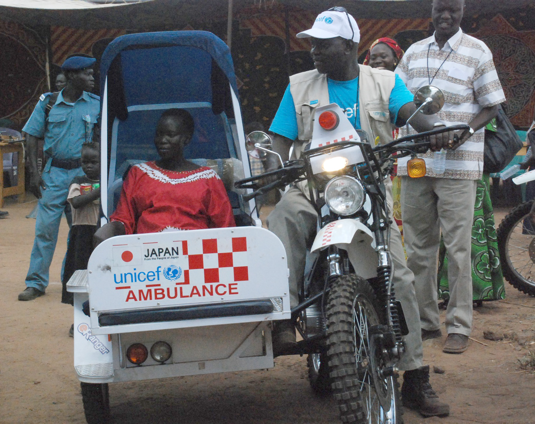 A motorbike ambulance is test driven in south Sudan at the launch of a pilot project aimed to cut maternal mortality