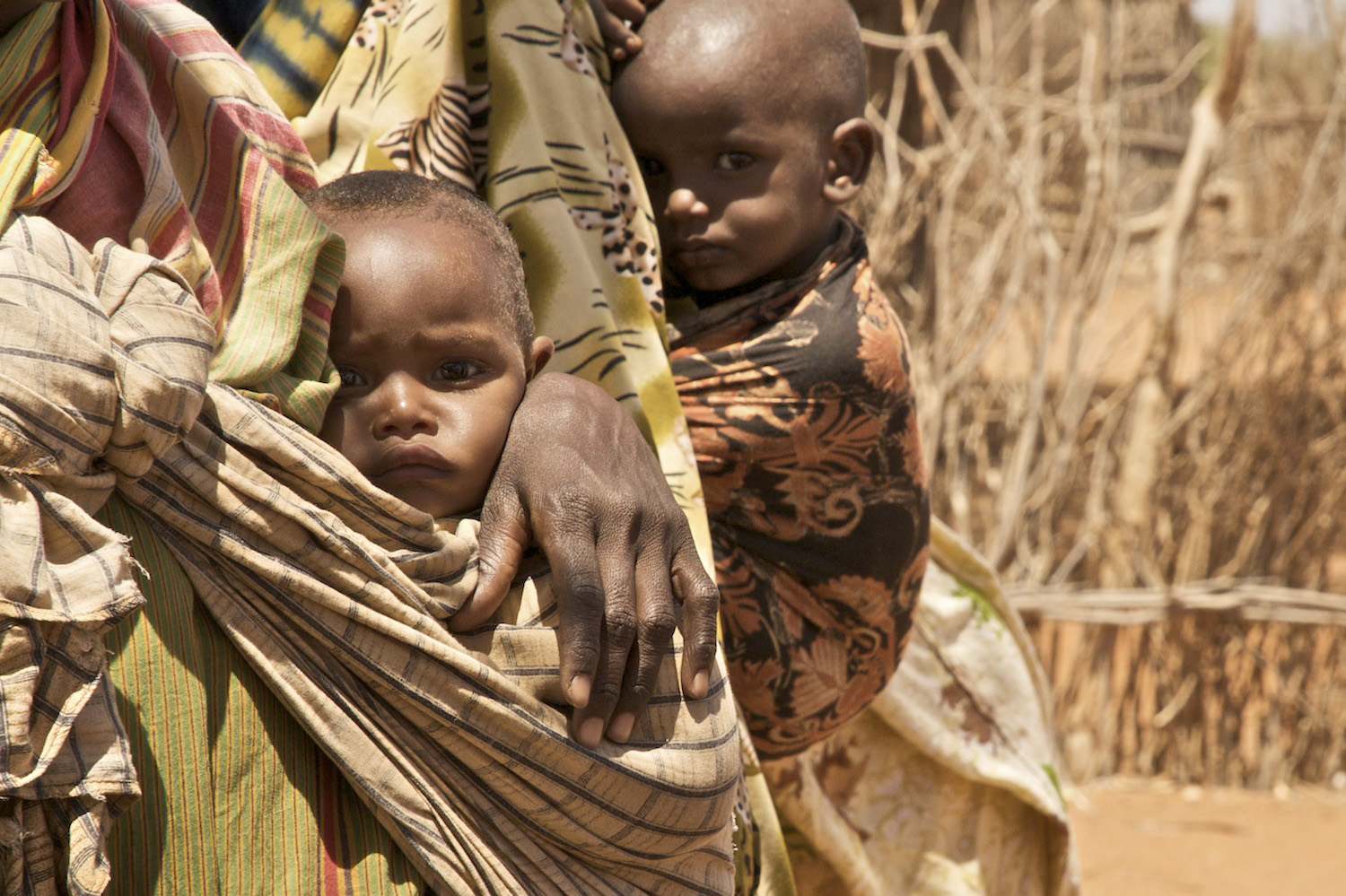 Two infants outside of  Save the Children's treatment center for malnourished children in Kutayu Village, in the Mandera district of Northeastern Kenya