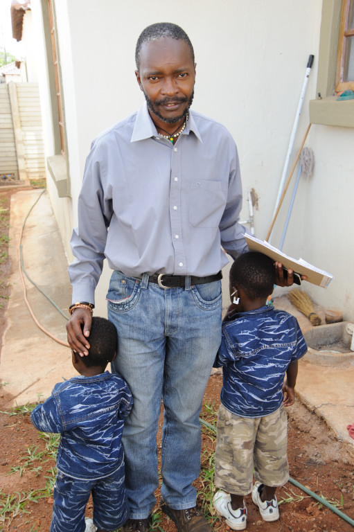 Sibelo Sibanda, of Lawyers for Human Rights in Musina, with two children suspected of being trafficked