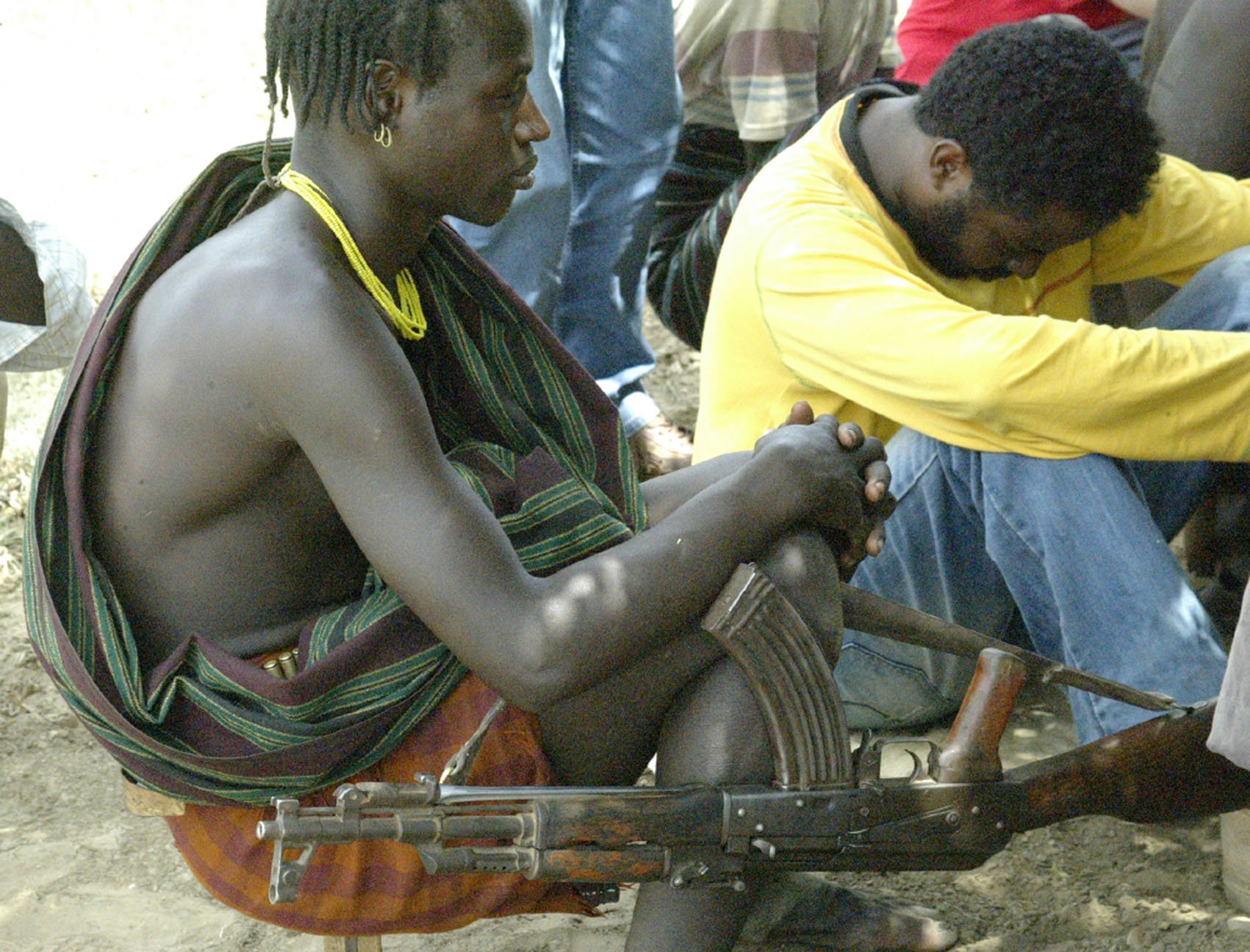 Members of the Hamer community carrying guns at a peace meeting in Turmi on 8 May