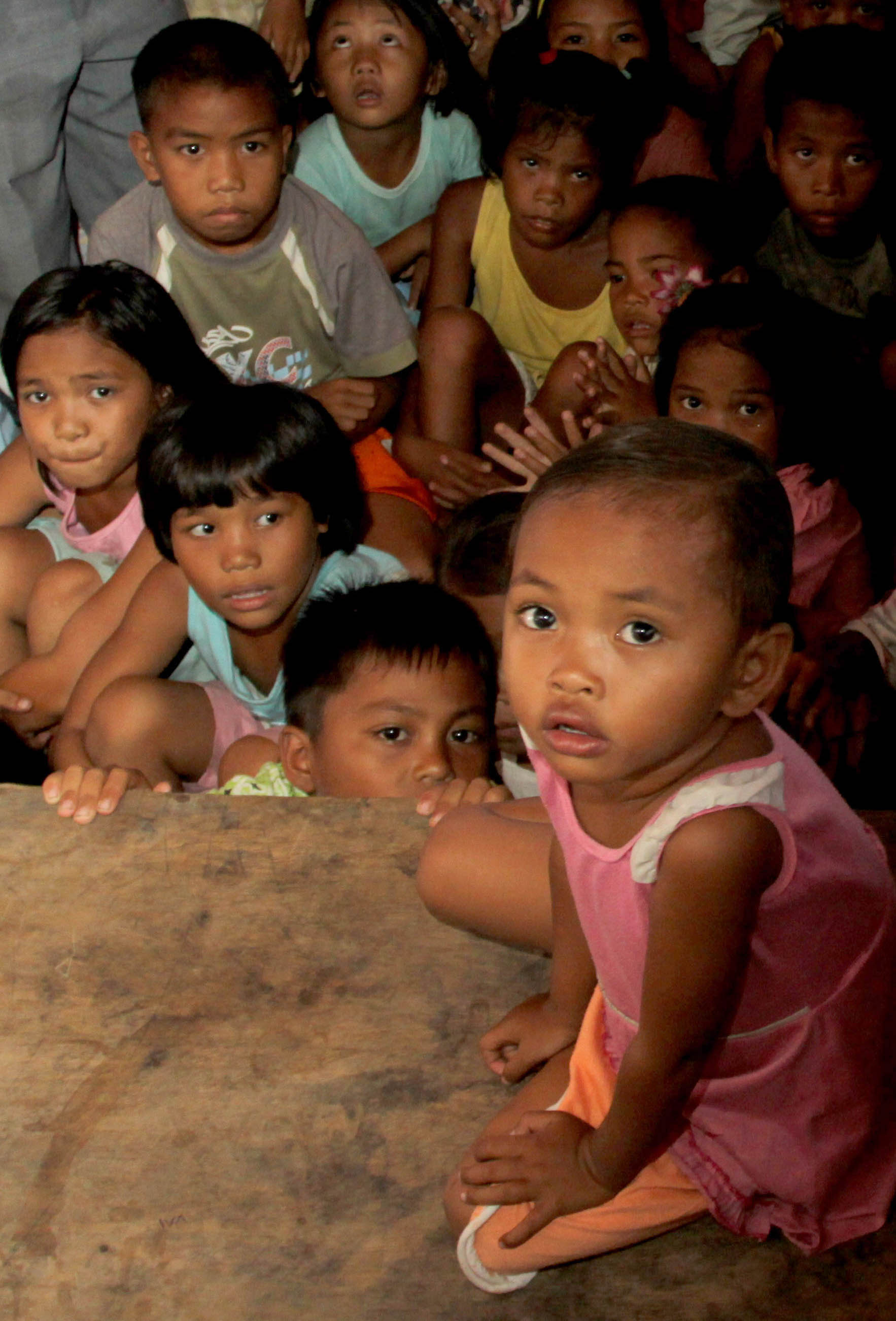 Children crowd under a tarpaulin tent at an evacuation camp in the village of Libungan Toretta, southern Philippines. Tens of thousands remain in evacuation camps across the southern island of Mindanao, nine months after an all-out war erupted between gov