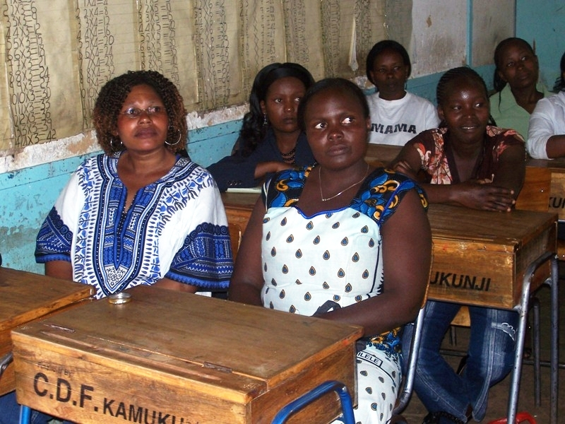 Kenyan domestic workers attend a seminar on HIV/AIDS held by the NGO, Family Health International