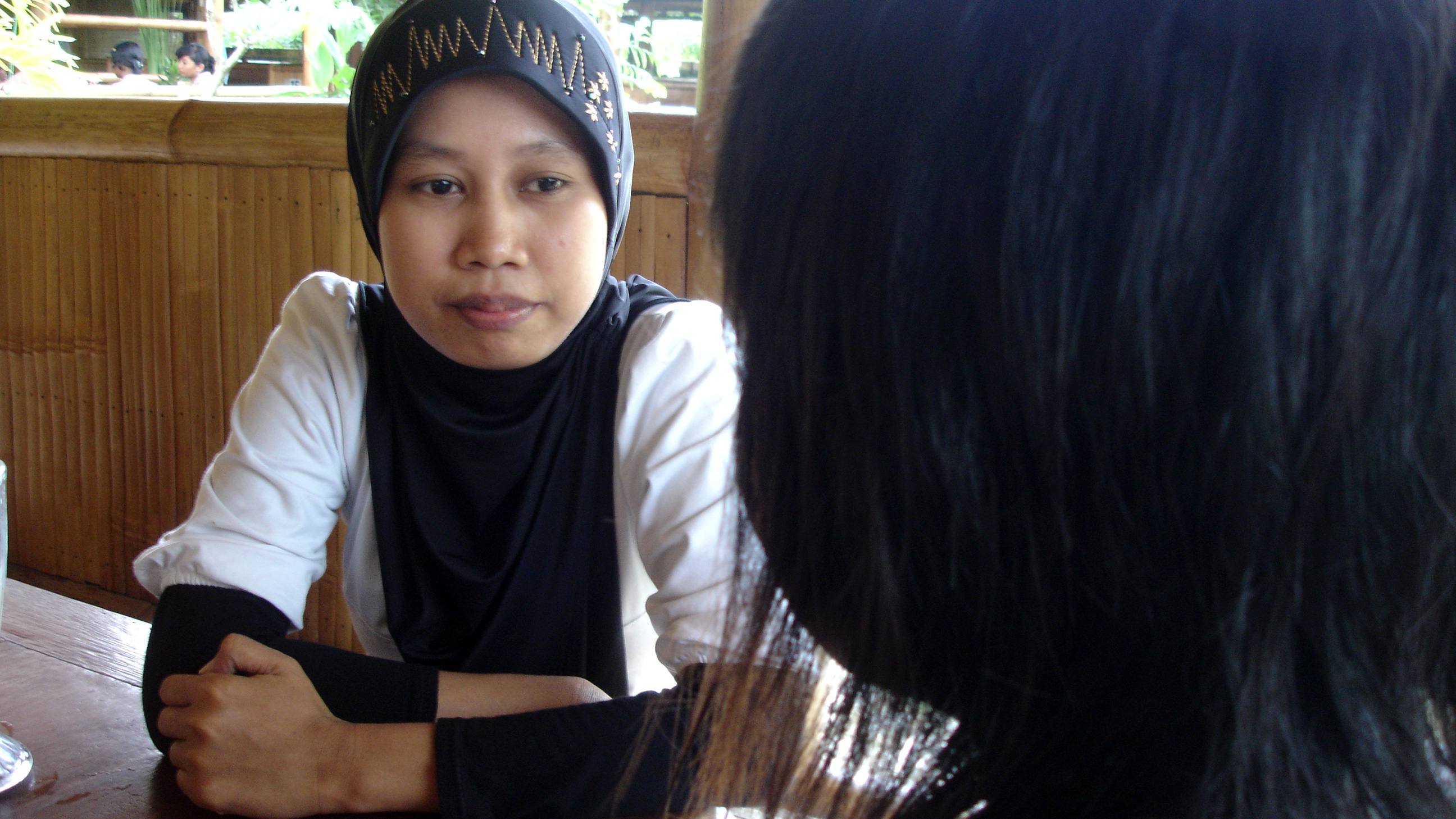 A Genta staff member counsels 19-year-old Isah. Some statistics suggest that 80,000 to 100,000 women and children are victims of sexual exploitation or have been trafficked for such purposes each year
