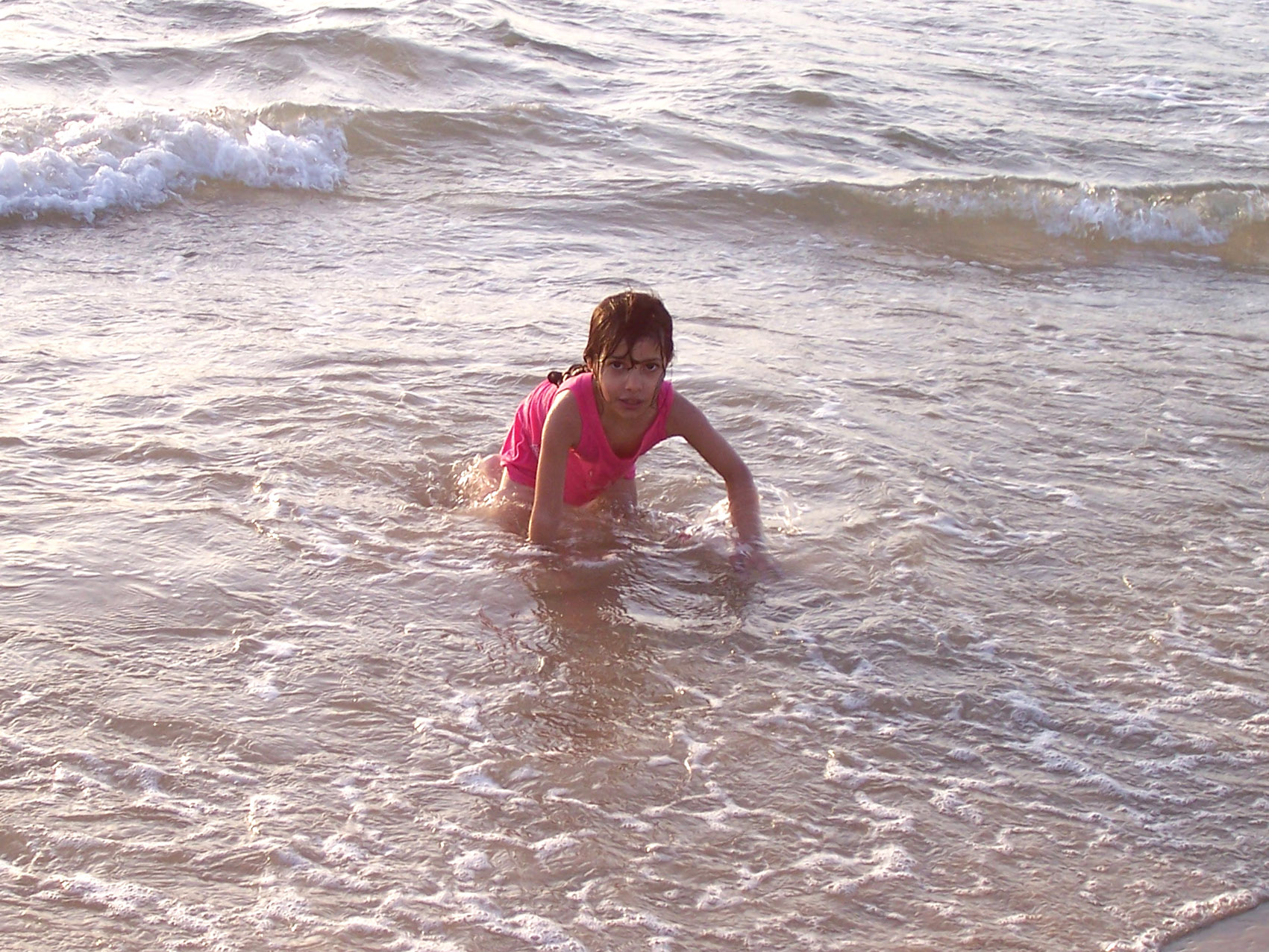 A child swims in the 'Shalihat' area in Gaza City despite warnings from the health ministry