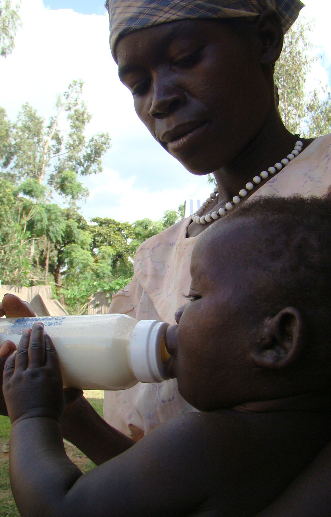 An HIV-positive morther in Gulu, northern Uganda, gives her baby cow's milk as a replacement for breastmilk in an effort to prevent vertical HIV transmission