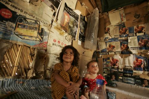 Displaced children sit in their makeshift shelter in an abandoned government building in Baghdad in 2008