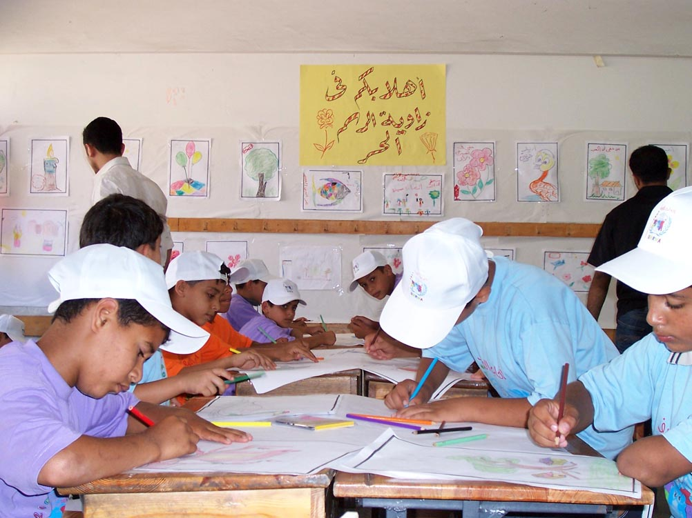 Campers engaging in arts and crafts activities at the Beach Elementary School C&D for Boys in Gaza City, part of the United Nations Relief and Works Agency for Palestine Refugees in the Near East (UNRWA) Summer Games that began last month in Gaza. Drawing