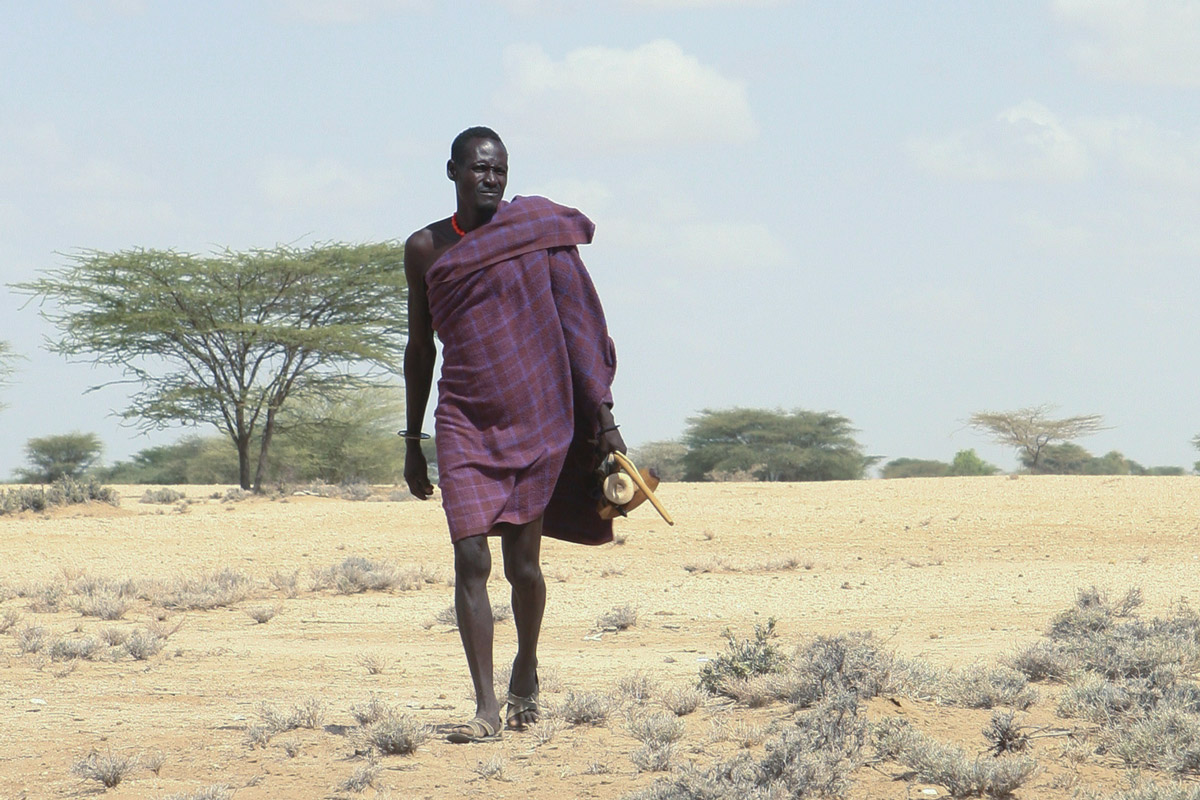 A Turkana man walks across the arid landscape of northwest Kenya, near the town of Lodwar. Many pastoralists in the region have lost animals to drought, theft and disease