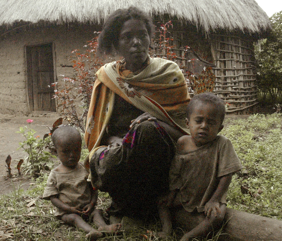 Abebech Angelo sits with her five-year-old twin boys, Nuhe and Merkeb,  at her home in Agaza Duge near Boditi town, 370 km south of Adis Ababa. Abebech has not yet receovered from the death of her one-year-old daughter, whose death was due to lack of food