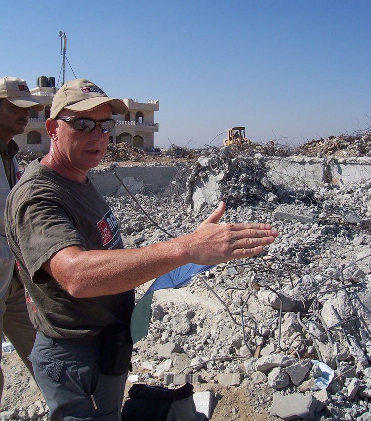 MAG director Mark Russell reviews a 'high risk' UNDP rubble removal site in Jabalyah, where seven anti-tank mines, rockets and artillery shells were discovered. UNDP teams are clearing rubble left behind from aerial bombardments during Israel's 23-d
