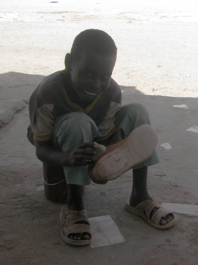 Ahmed Nour Mohamed, 9, makes a living by polishing shoes on the streets of Hargeisa, Somaliland