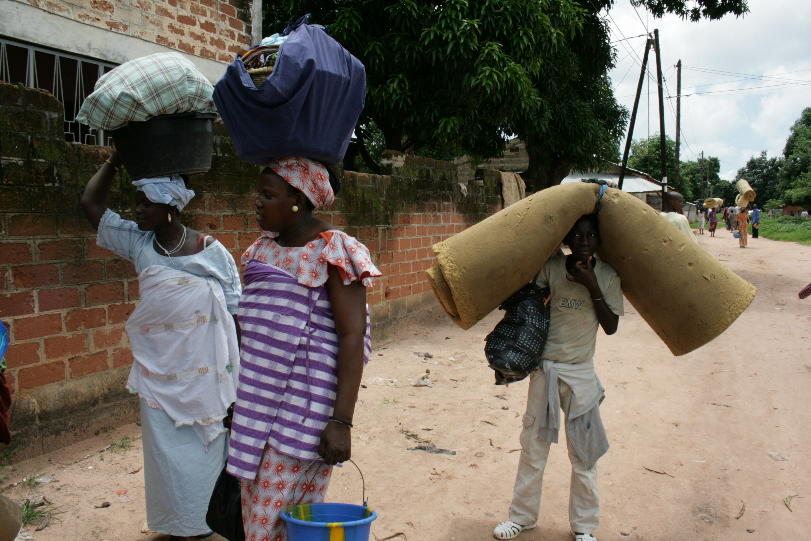 Families fleeing their neighbourhood of Diabir on the outskirts of Ziguinchor, the main city in Senegal's Casamance region, following clashes between the army and separatist rebels. September 2009