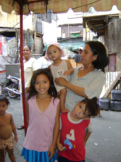 A Manila resident with four of her 10 children