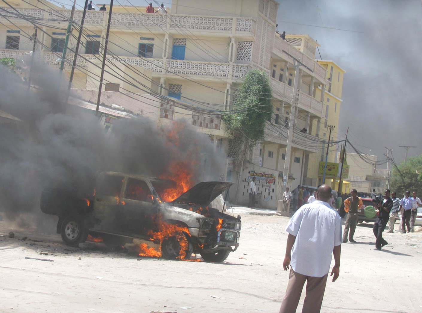 A government car is set ablaze in Hargeisa, capital of the secessionist territory of Somaliland, on 12 September as opposition supporters and civil service activists protested the closure of the lower house of representatives