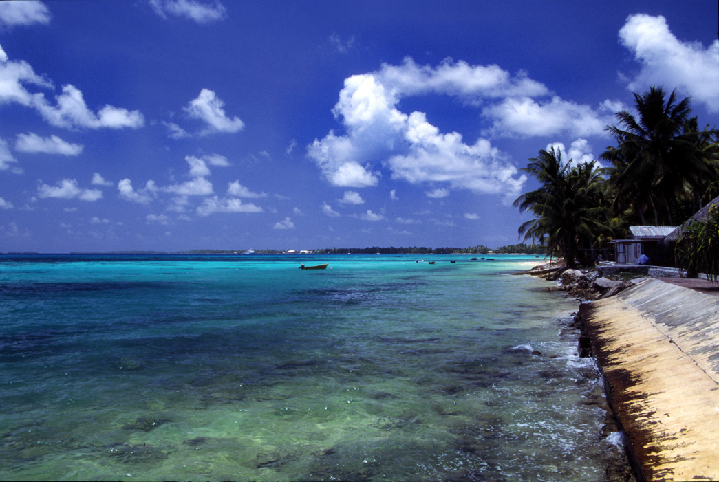A beach at Funafuti atoll, capital of Tuvalu, a Polynesian island nation located in the Pacific Ocean, midway between Hawaii and Australia. With a population of less than 12,000, Tuvalu is likely to disappear in the future because of rising sea levels