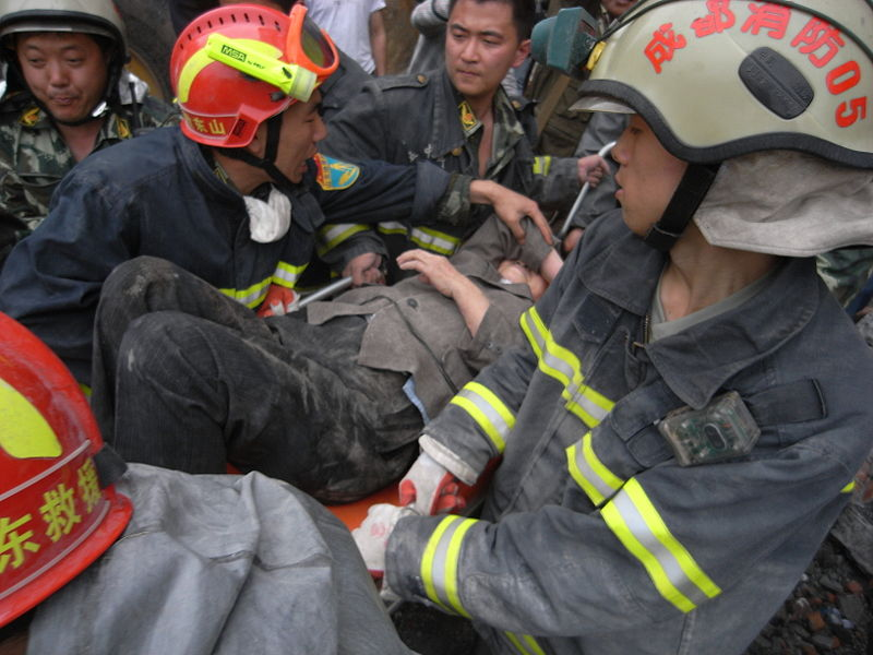 An old woman was rescued after being trapped for over 50 hours. Dujiangyan, 2008 Sichuan Earthquake