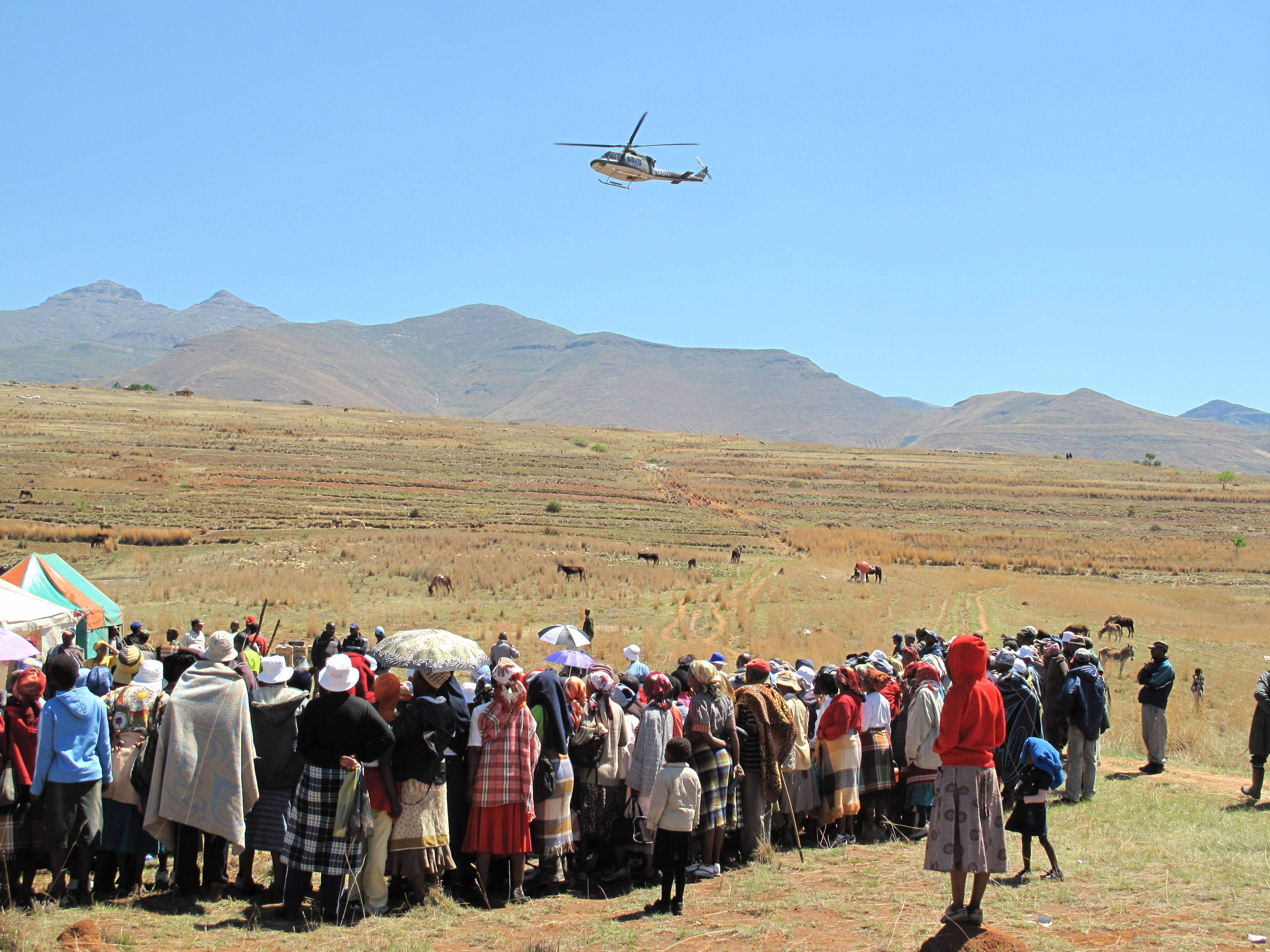 Some 400 Km from the capital Maseru in Thaba Khubelu, a tiny village in the mountainous district of Qacha's Nek - one of the most remote areas in Lesotho - some 250 households, eagerly watched as a military helicopter touched down to deliver their first