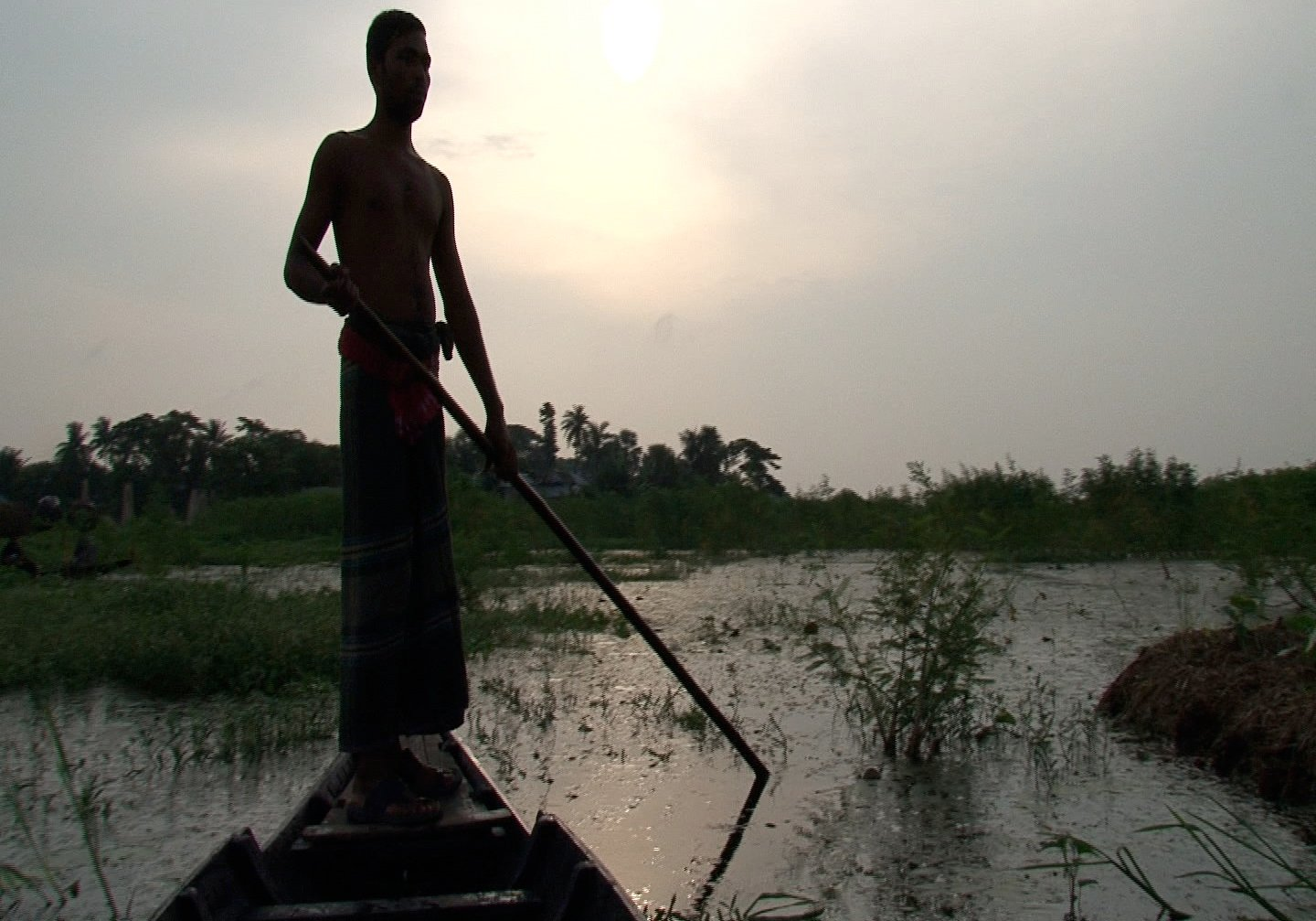 Sujit Kumar Mondal sailing to his floating garden