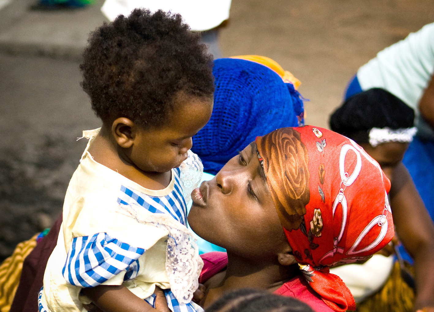 "Stella plays with a child at the Heal Africa Transit Center in Goma, DRC. According to Gender-Based Violence Expert, Mendy Marsh, a key component of reintegration after sexual violence is ""for the women to feel like they can move on and take care of their"