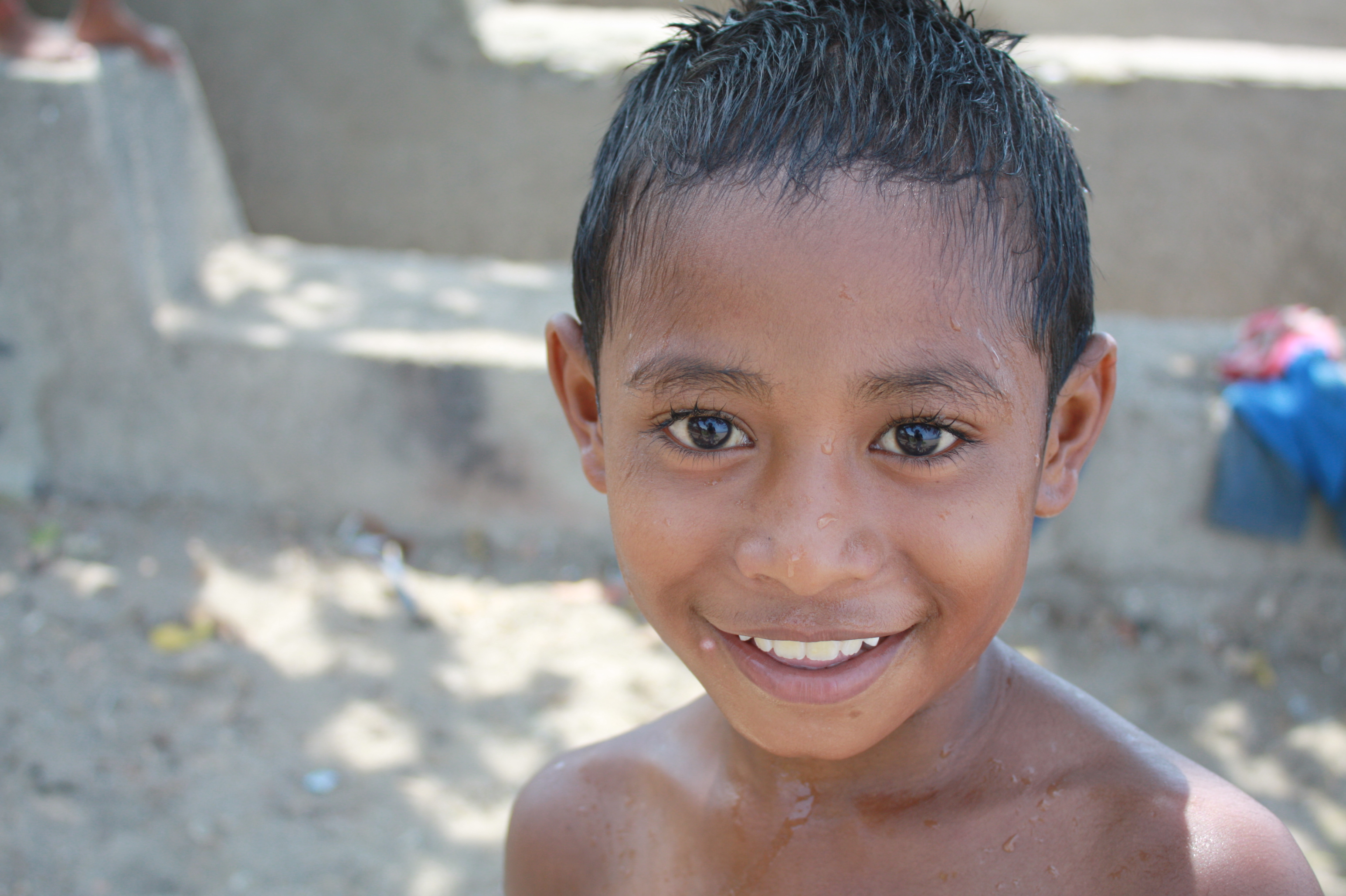 A young boy on the beachfront in Dili. Timor-Leste, the world's newest nation, is also one of the poorest