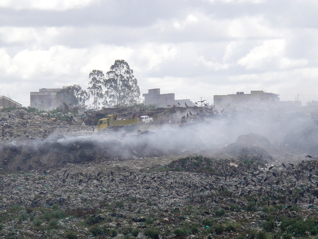 A dump truck delivers waste at Dandora site in Nairobi