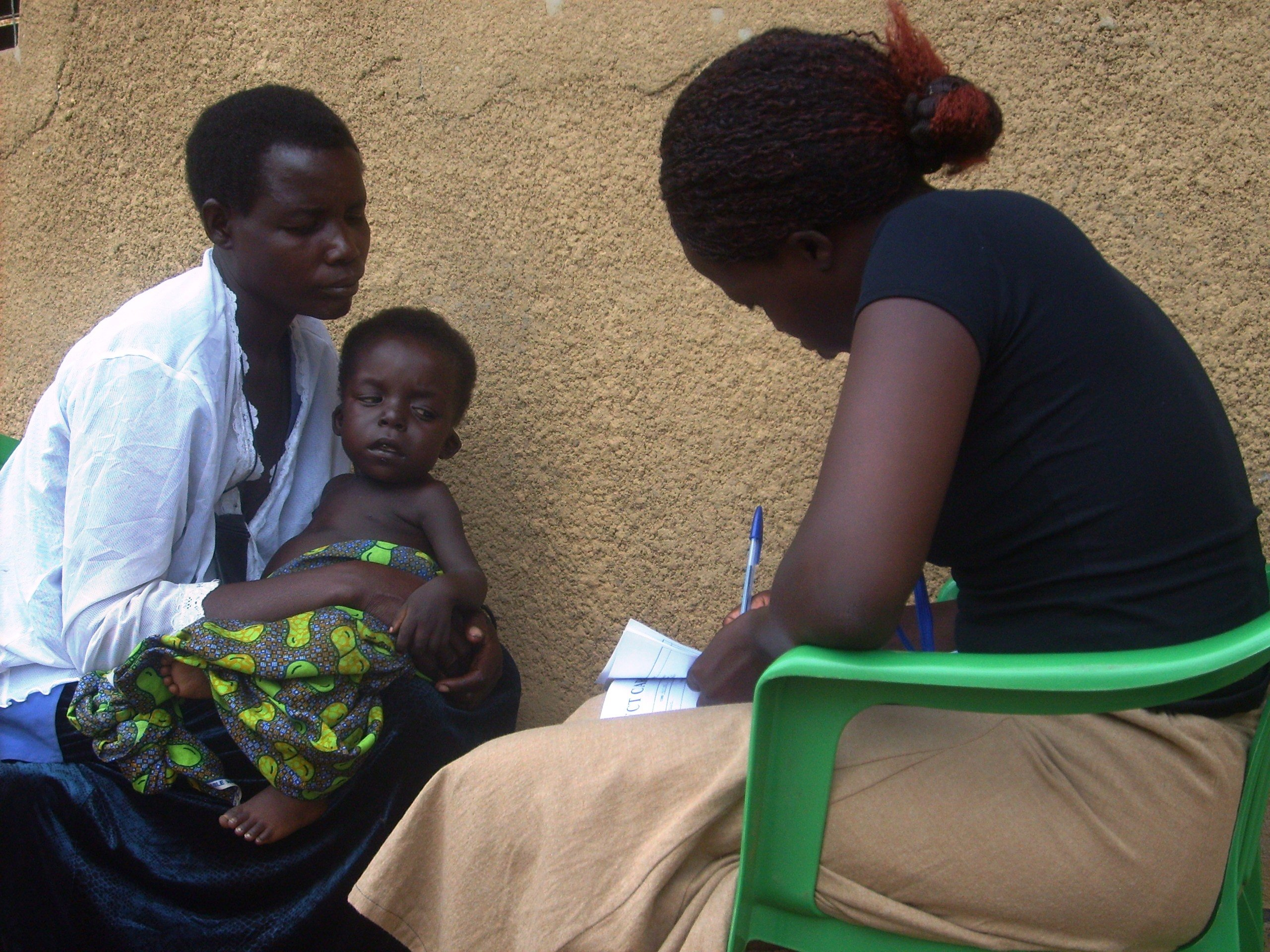 A mother receives home counselling before her HIV test in Alito sub-county, Apac District, Uganda