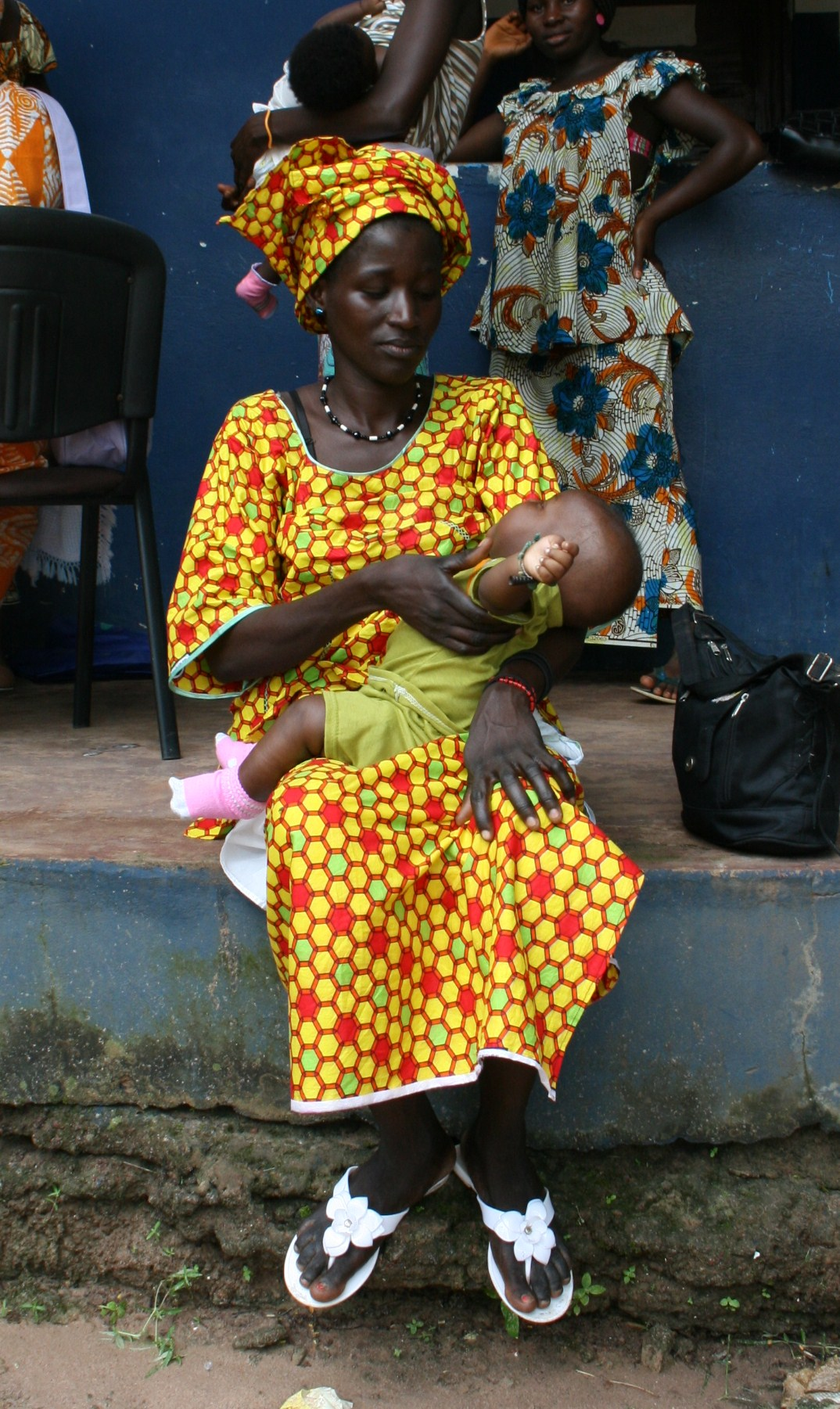 Woman waiting for her baby to be vaccinated at San Domingos hospital 90km from Bissau