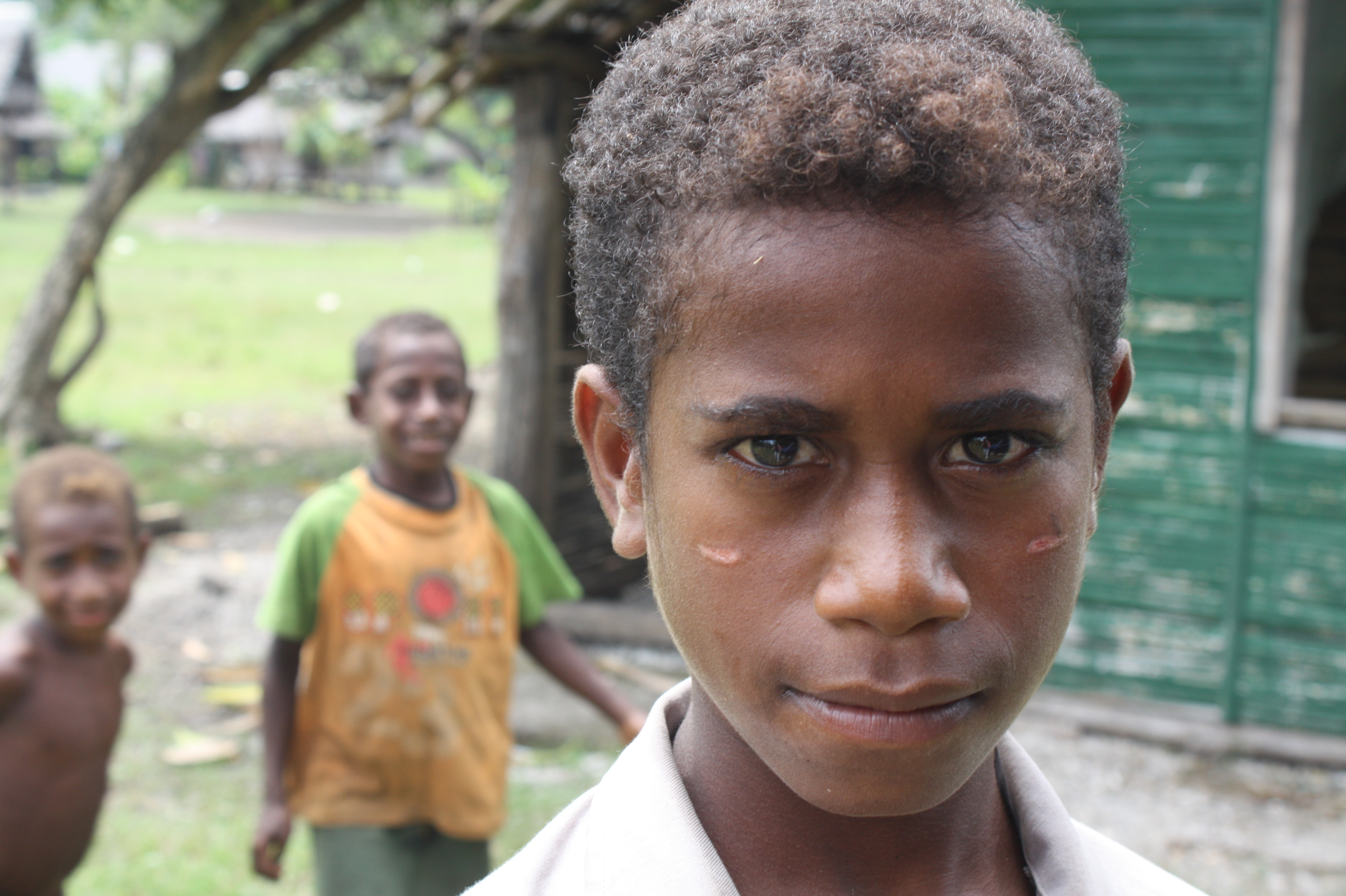 A young boy at the Mangem IDP centre in Madang. Many children are losing out on education