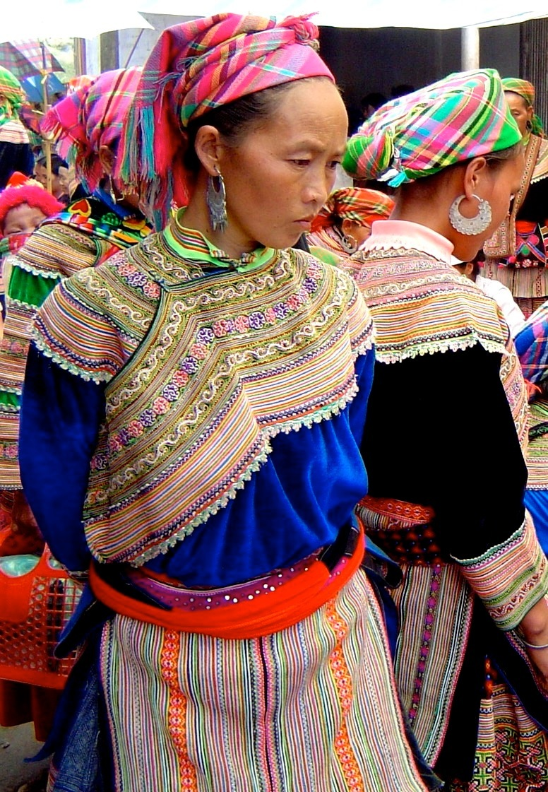 A Hmong woman wearing traditional clothes in a market in Vietnam