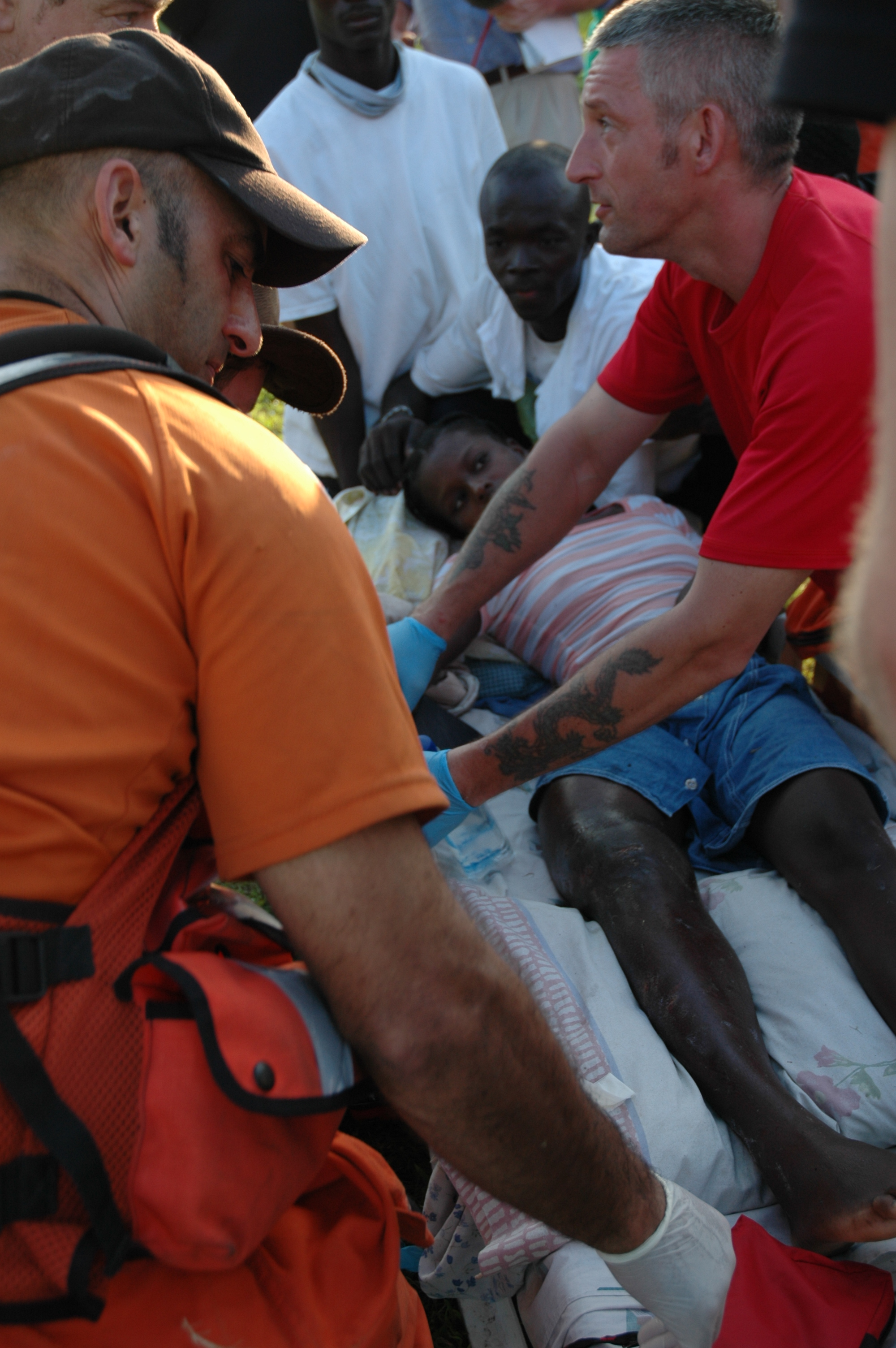 Rescue workers treat an injured survivor, Leogane, Haiti, Jan 2010