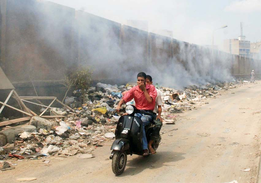Piles of garbage being burned in Cairo's streets put residents in danger of contracting respiratory diseases