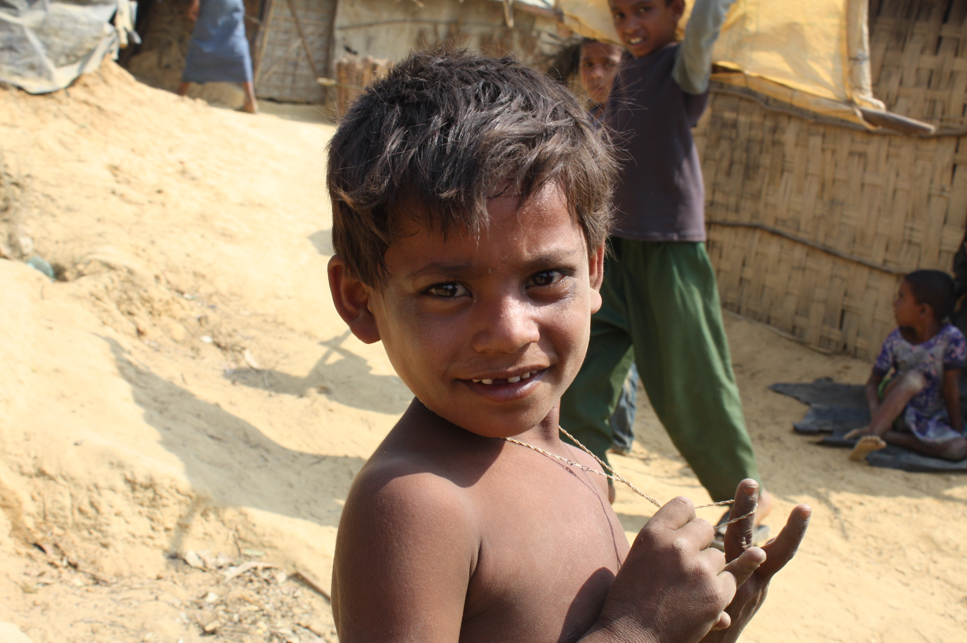 A young boy at the Kutupalong refugee makeshift site outside Cox's Bazar. Water, sanitation and food are key concerns at the site following an increasing number of undocumented refugees at the site