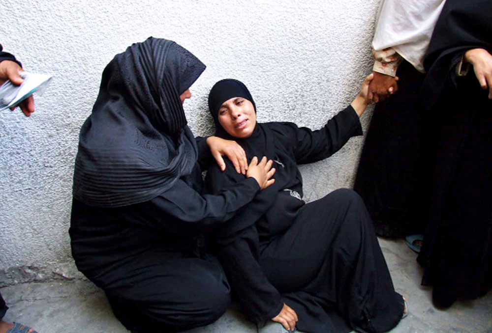 A woman cries after the loss of one of her sons in Kamal Adwan Hospital in the Gaza Strip. Palestinian women face a variety of hardships