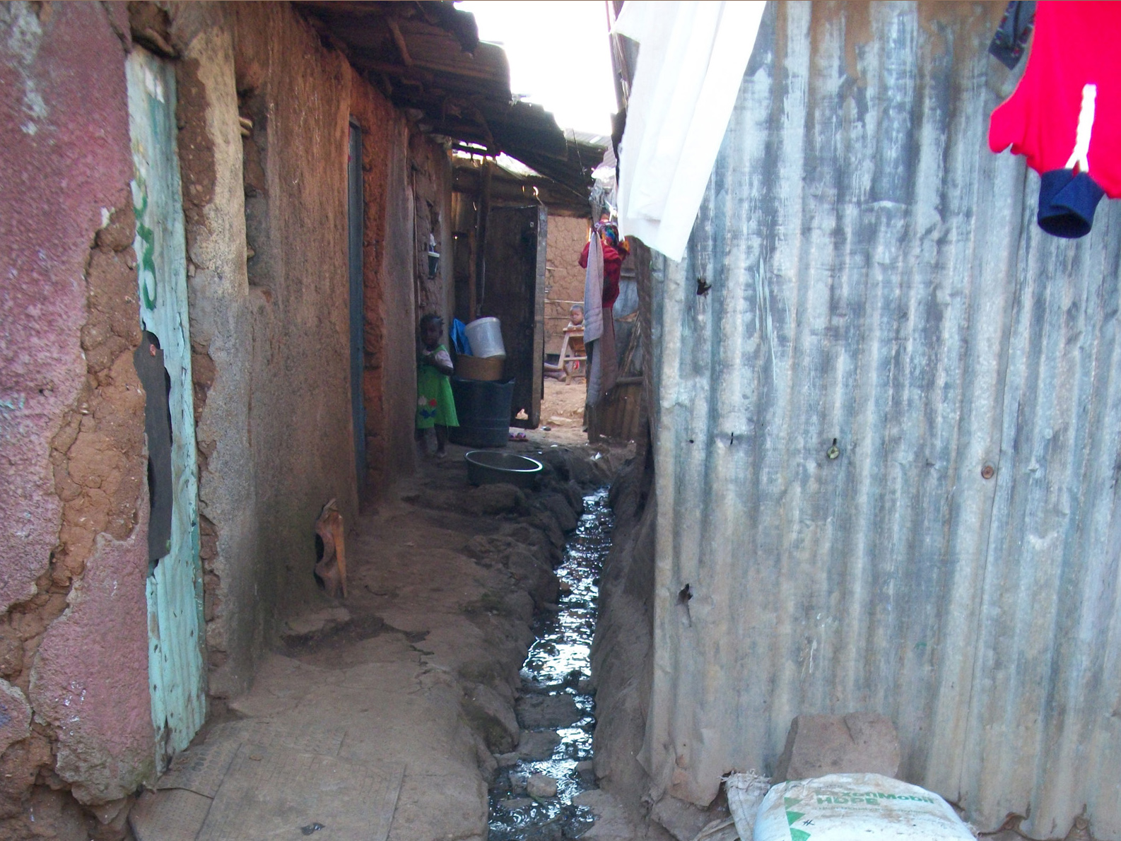 Clogged drainage channels in the sprawling Korogocho slums of Nairobi. Poor waste disposal is an inherent health danger to the residents. The narrow channels empty their contents into the Nairobi River highly polluting it. Such poor waste disposal is a ri