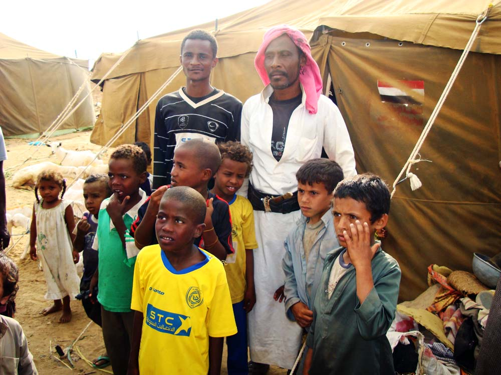 IDPs next to their tents in Mazraq Camp. Up to 270,000 people had been displaced by the latest flare-up