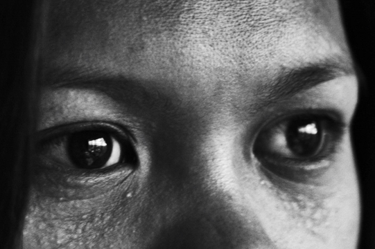 The eyes of a trafficking victim. Thousands of women in the Philippines fall victim to traffickers each year