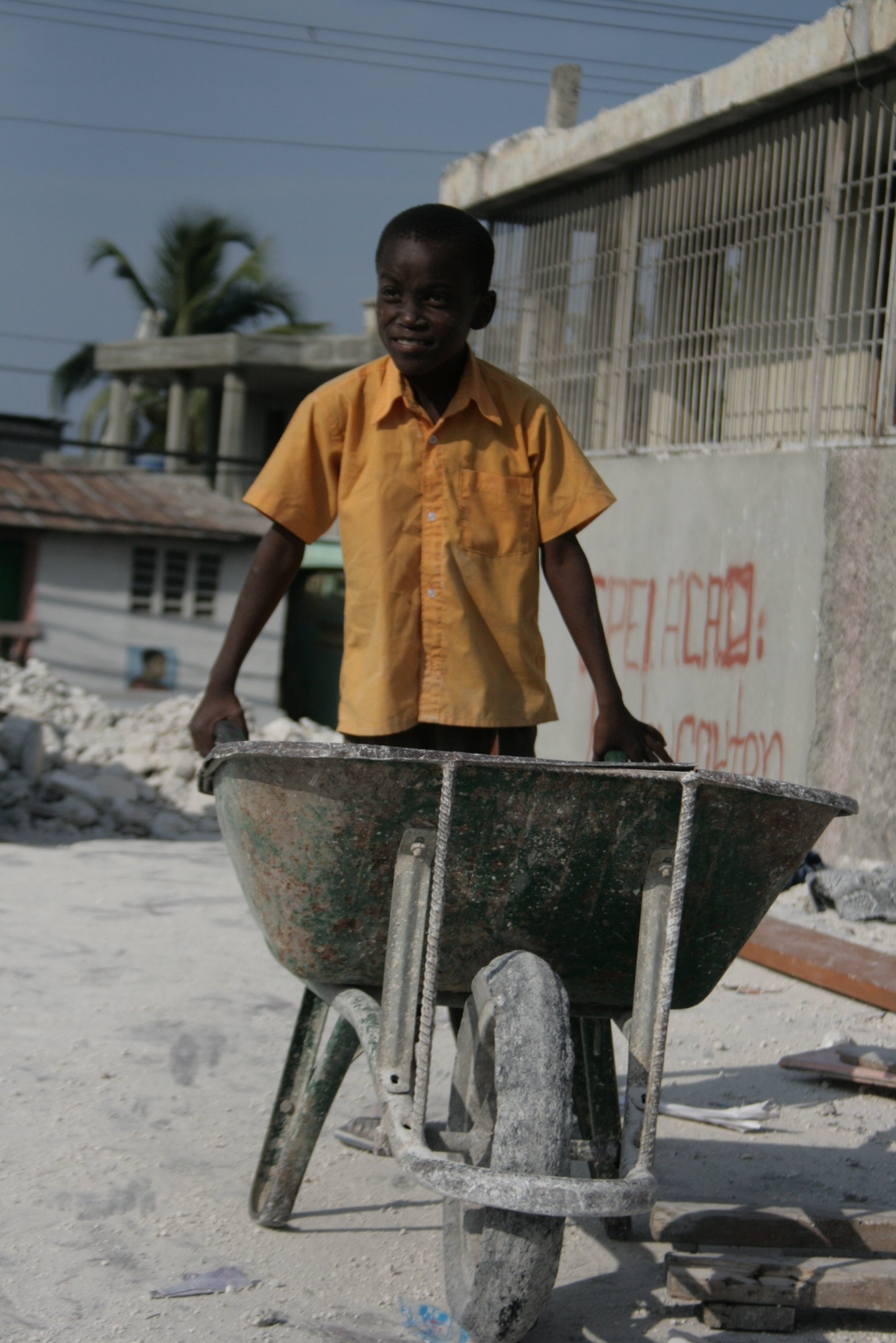 Boy takes part in cleaning up earthquake rubble at a church/school building in the Martissant neighbourhood of Port-au-Prince. March 2010