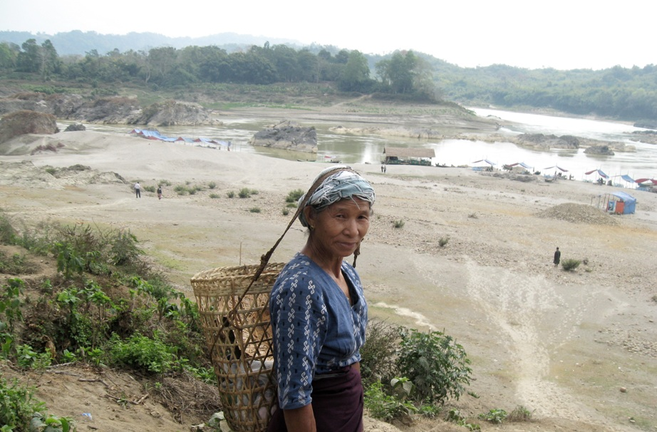 A Kachin woman stands before the proposed site of the Myitsone Dam. According to activists, 15,000 people will be displaced by its contruction