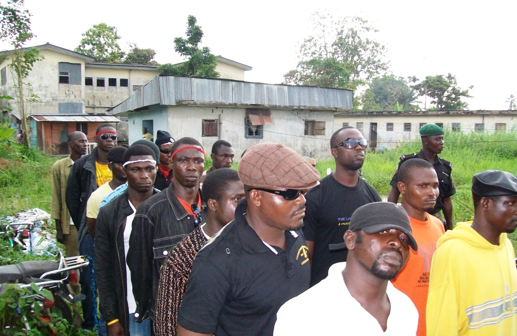 Militants line up to hand in their weapons and register for the government amnesty programme in Delta State