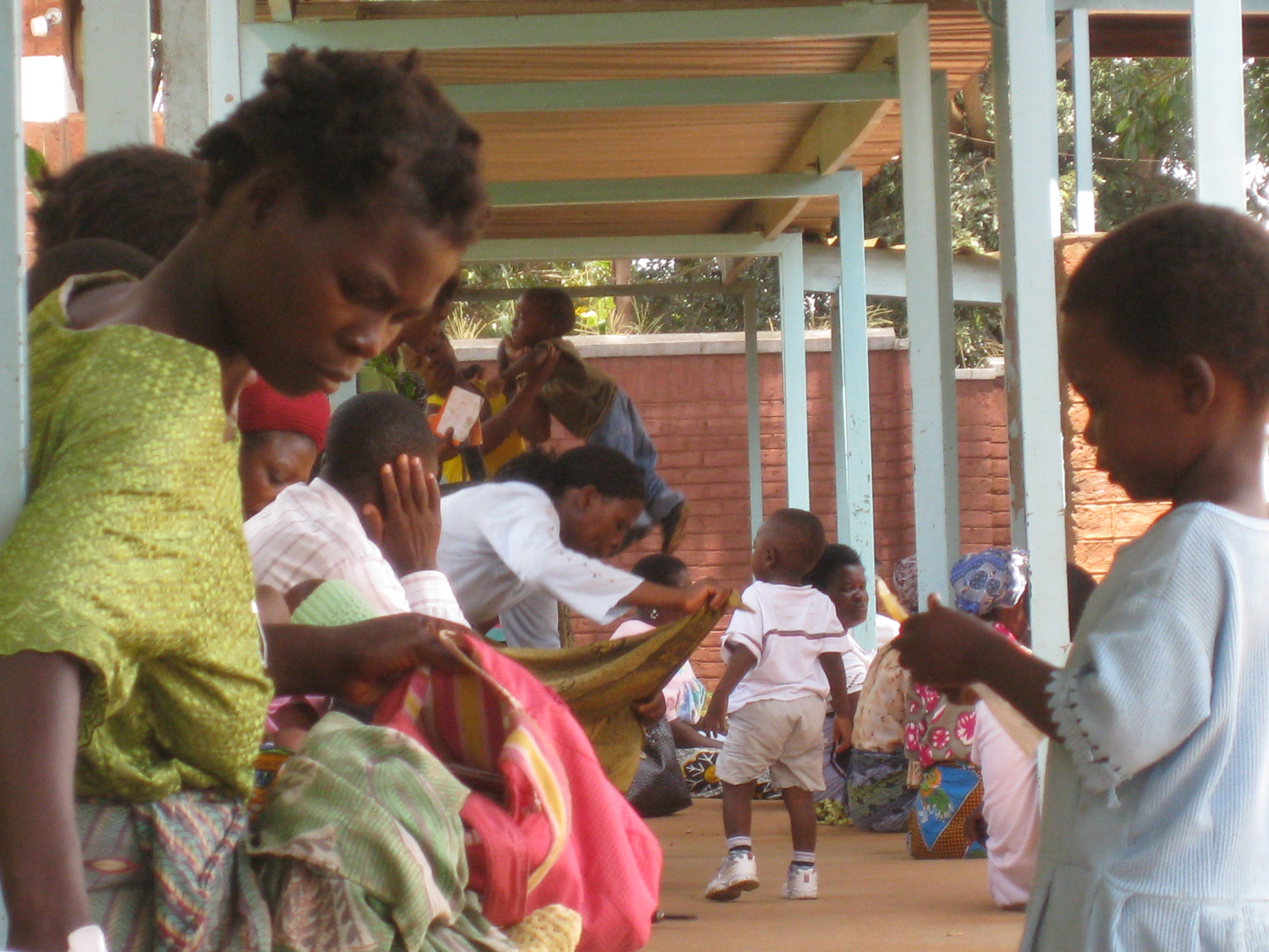 A mother and her child wait to see a nurse at Kawale Clinic in Lilongwe, Malawi