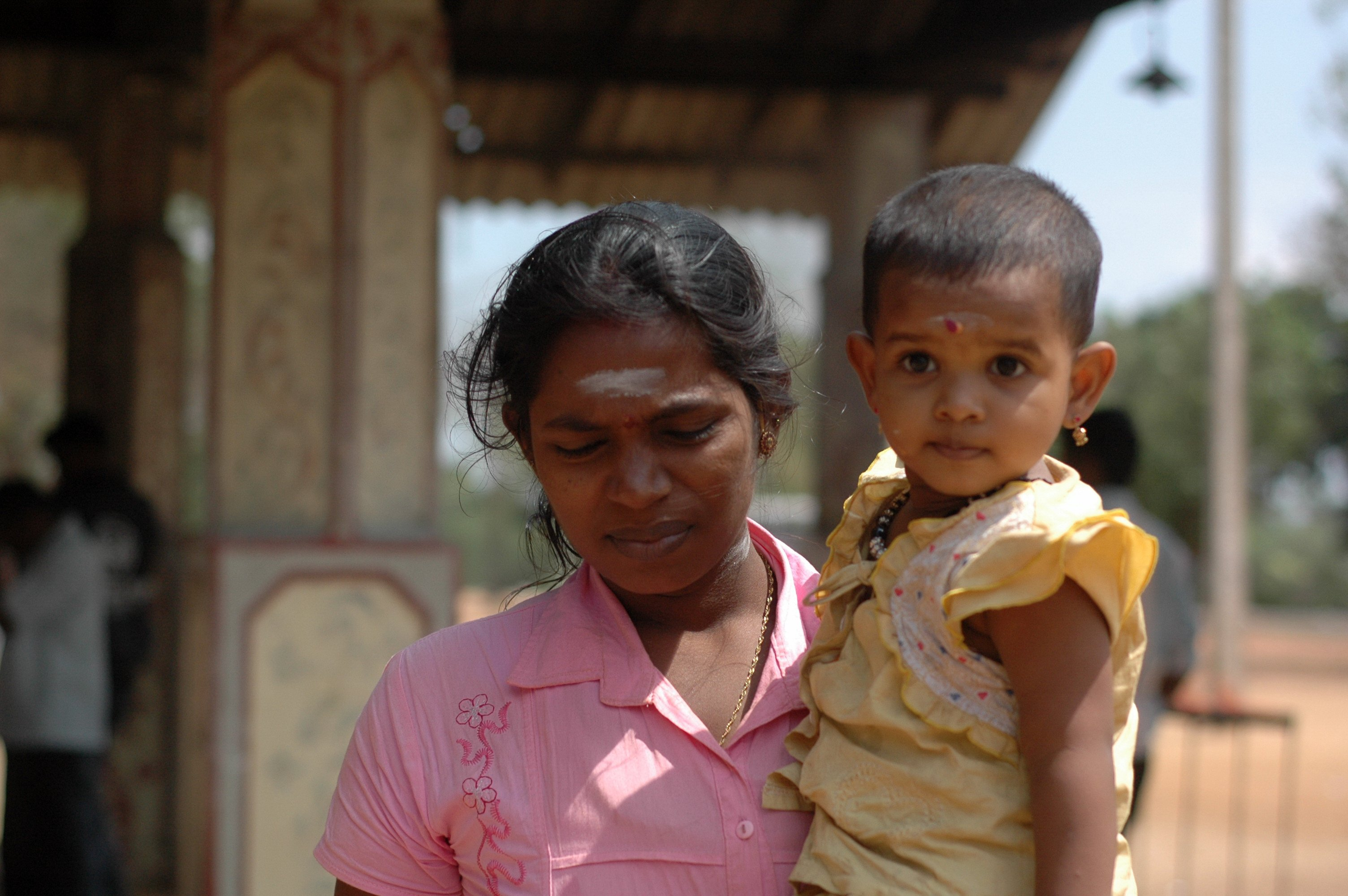 A mother and child outside the Murugandi temple, south of Kilinochi, the former de-facto capital of the LTTE