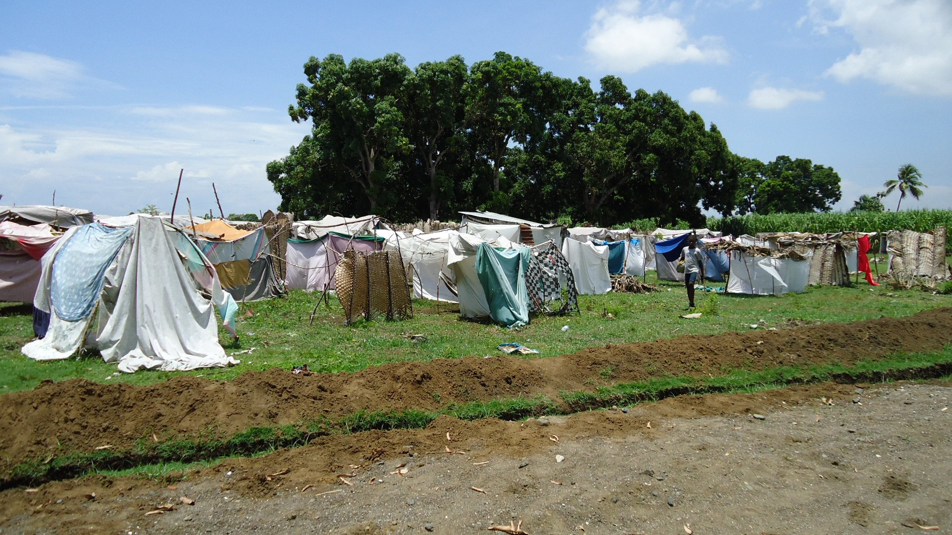 'Habitation Augustin' camp for displaced families in Léogane, Haiti, just before a tarpaulin distribution organised by ACTED on 21 May 2010