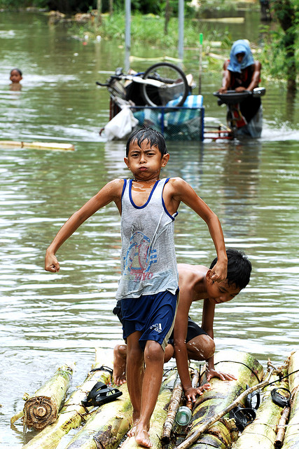 Residents of Los Baños and Bay towns, along the coast of Laguna de Bay and about 60 kilometers south of Manila, cope with floodwaters that have not receded 3 days after Typhoon Ondoy ravaged the Philippines