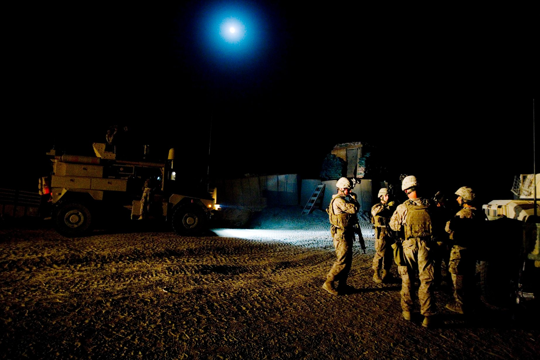 Marines gather for a briefing before going out on night patrol in Mian Poshteh