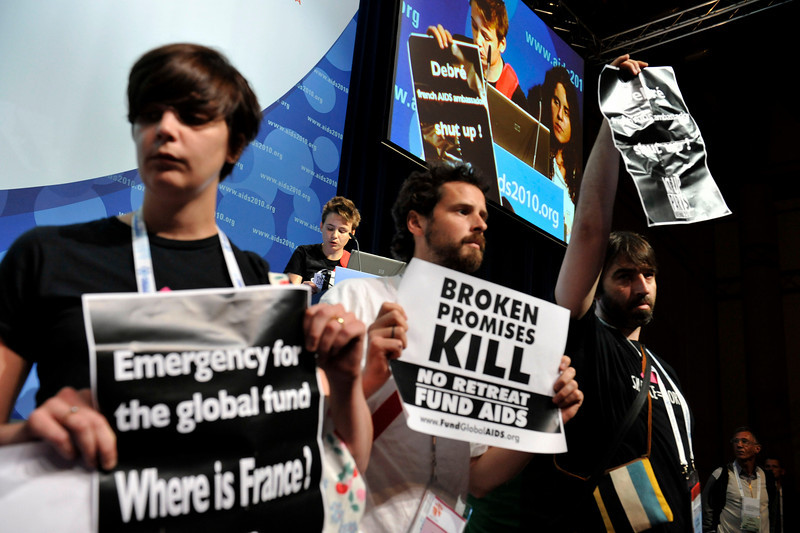 AIDS activists storm the stage at the opening of the International AIDS Conference in Vienna