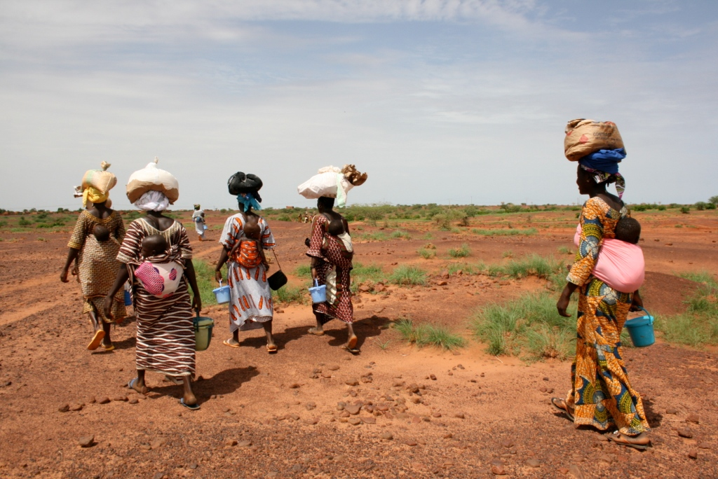 Mothers walking home with supplementary rations for their under-two children in Niger's central region of Tahoua