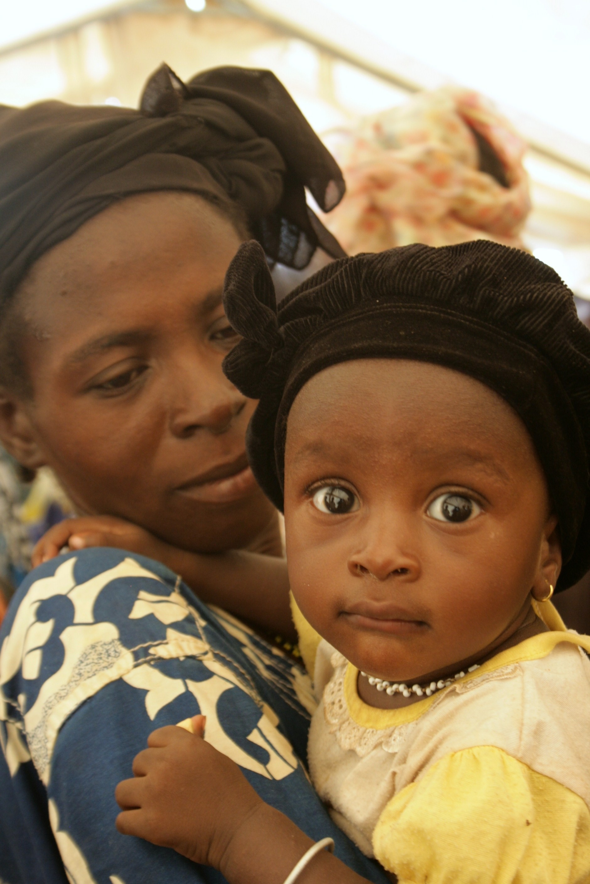 Woman and her child in a village near the Burkina Faso capital Ouagadougou, April 2010