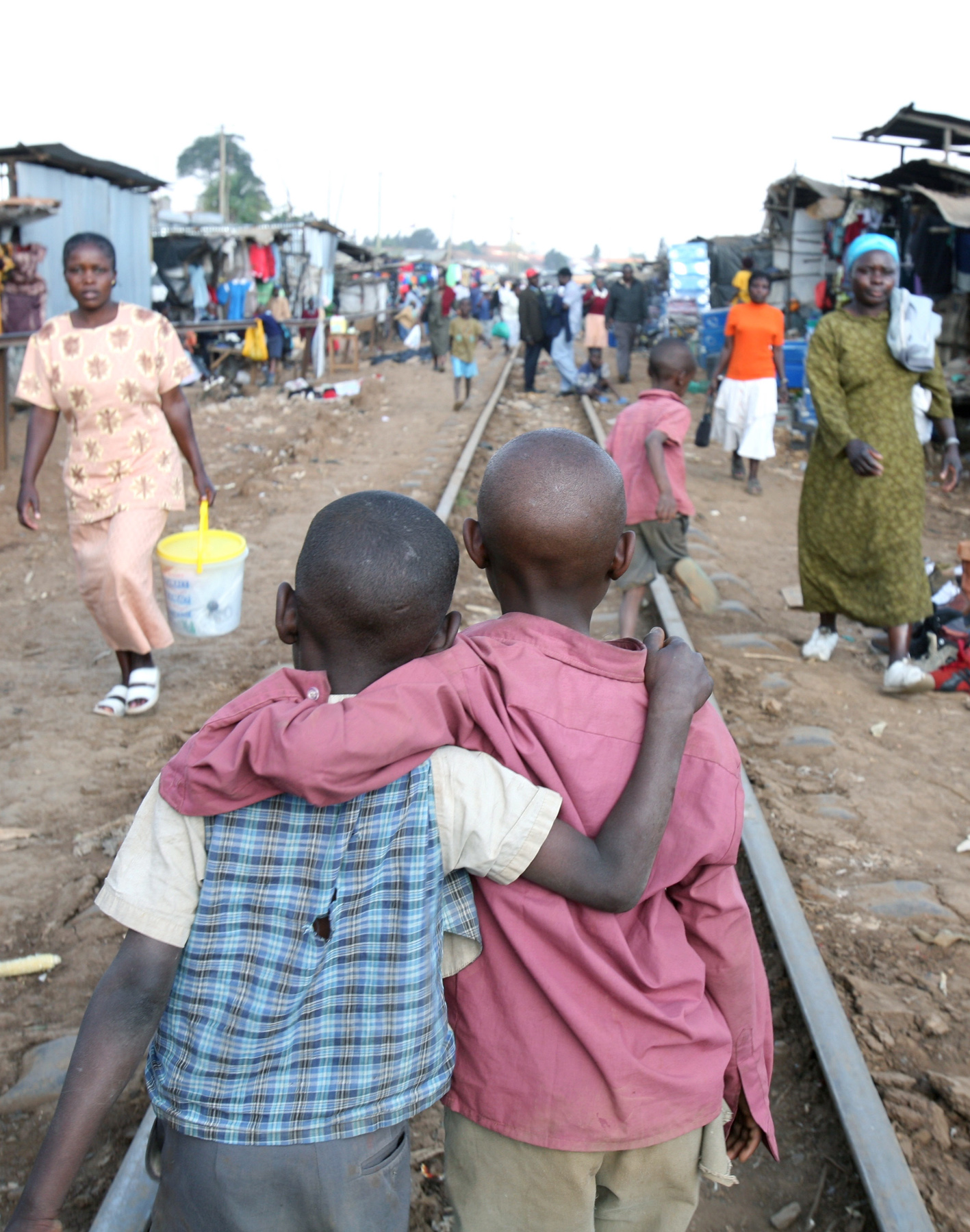Young boys on their way home from school in the Kibera slum, Nairobi