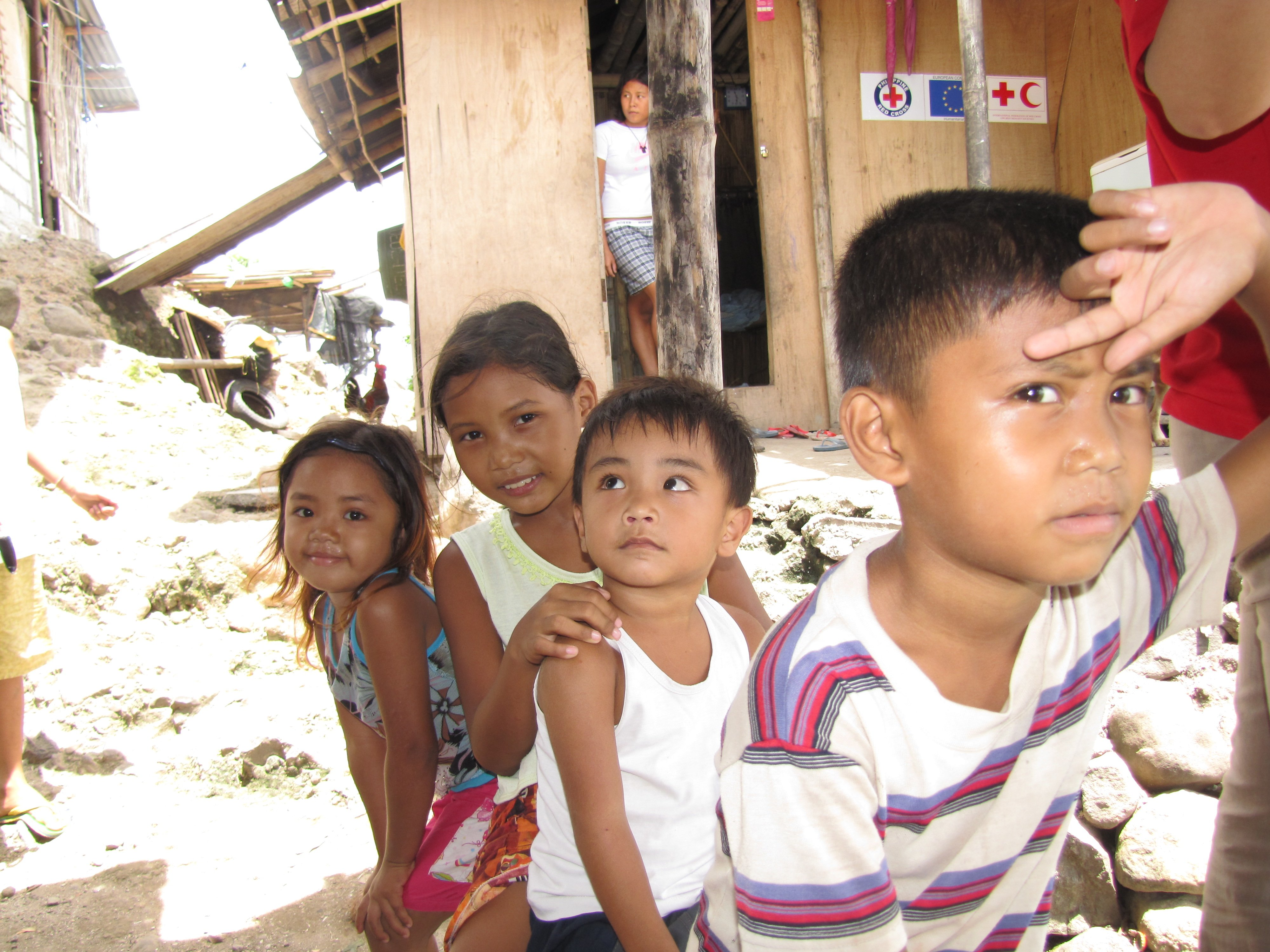 One year after Ketsana, children living on the edge of Laguna Lake. Metro Manila lies on the western shore. Thousands were displaced by the storm which struck on 26 September 2010