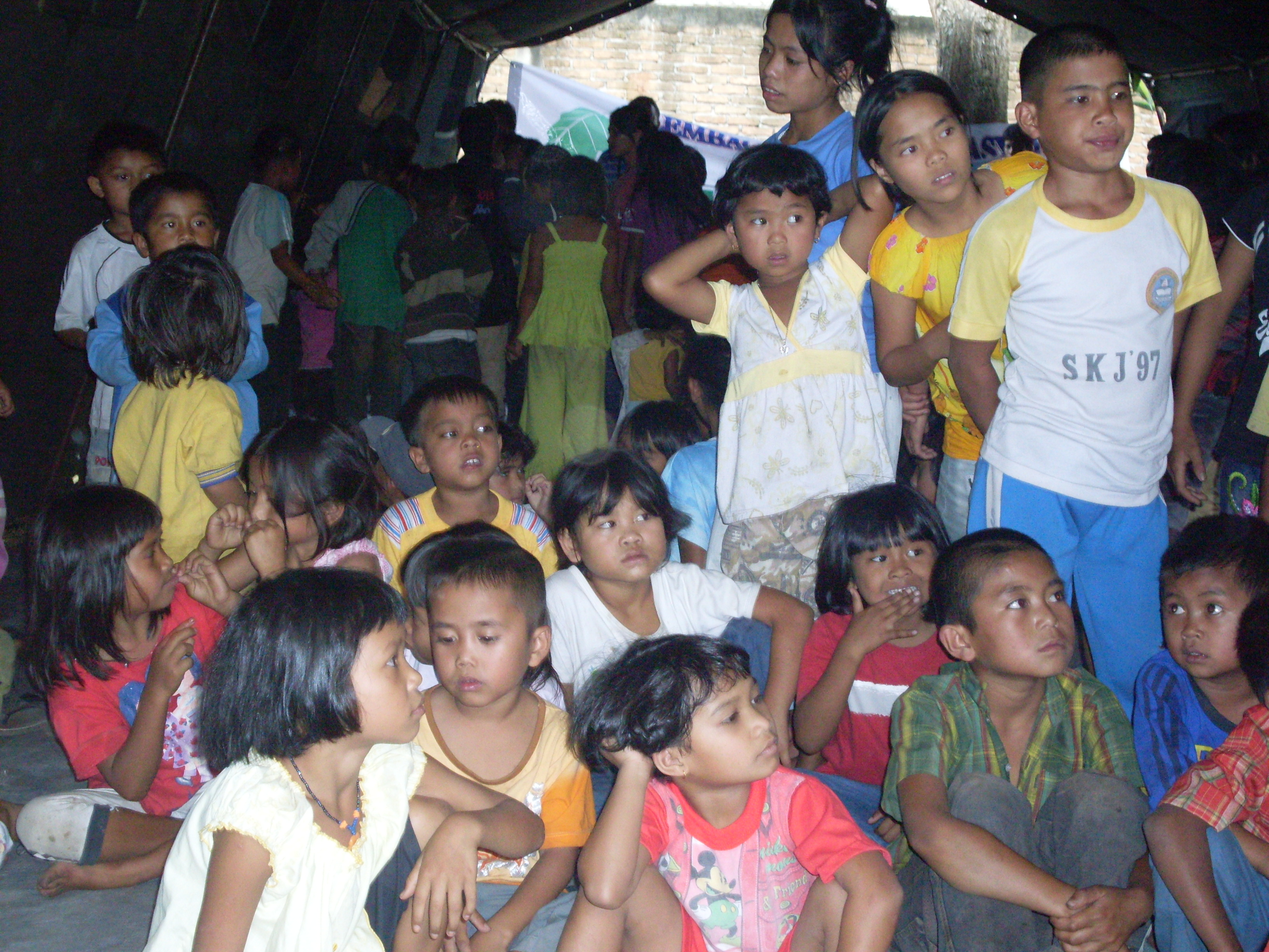 Children staying in a tent at an evacuation posts in Karo District, North Sumatra Province. Thousands fled their homes after the once dormant Mount Sinabung volcano began erupting at the end of August 2010